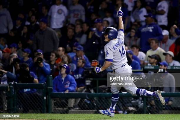 Enrique Hernandez of the Los Angeles Dodgers celebrates hitting a home run in the ninth inning against the Chicago Cubs during game five of the...