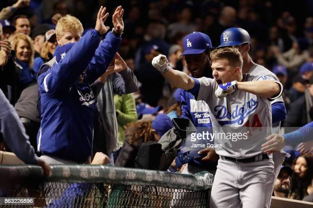 Enrique Hernandez of the Los Angeles Dodgers celebrates with teammates after hitting a grand slam in the third inning against the Chicago Cubs during...