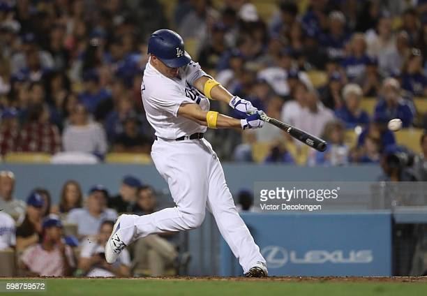 Enrique Hernandez of the Los Angeles Dodgers doubles to the left field during the fourth inning of their MLB game against the San Diego Padres at...