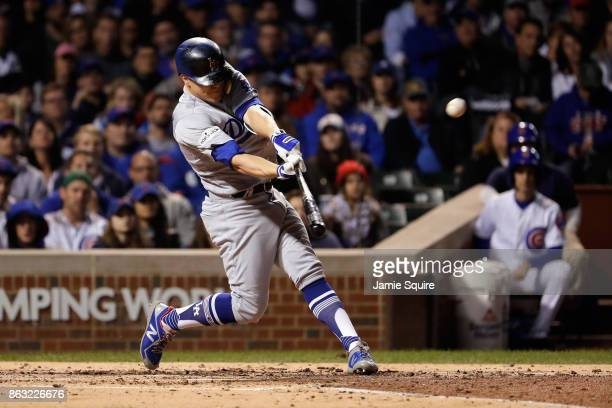 Enrique Hernandez of the Los Angeles Dodgers hits a grand slam in the third inning against the Chicago Cubs during game five of the National League...