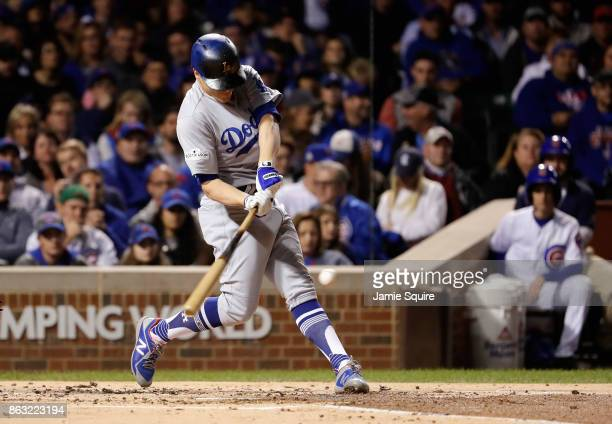 Enrique Hernandez of the Los Angeles Dodgers hits a home run in the second inning against the Chicago Cubs during game five of the National League...