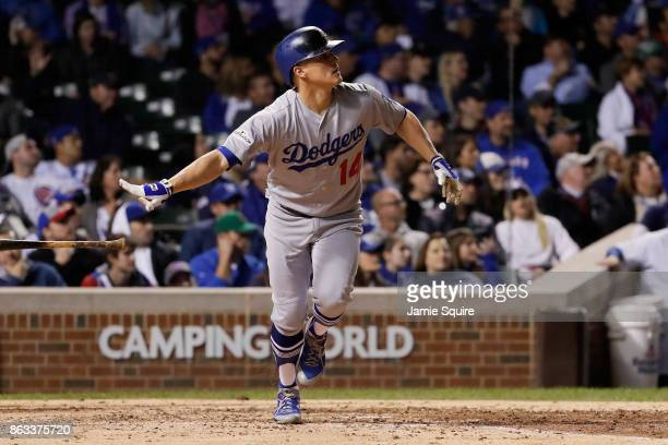 Enrique Hernandez of the Los Angeles Dodgers hits a home run in the ninth inning against the Chicago Cubs during game five of the National League...