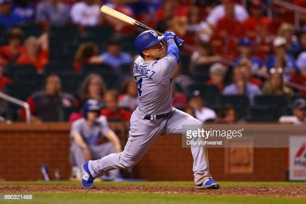 Enrique Hernandez of the Los Angeles Dodgers hits a sacrifice RBI against the St Louis Cardinals in the ninth inning at Busch Stadium on May 30 2017...