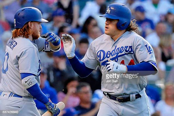 Enrique Hernandez of the Los Angeles Dodgers is congratulated by Justin Turner after hitting a one run home run against the Chicago Cubs during the...