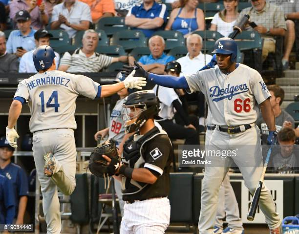 Enrique Hernandez of the Los Angeles Dodgers is greeted by Yasiel Puig of the after hitting a home run against the Chicago White Sox during the...
