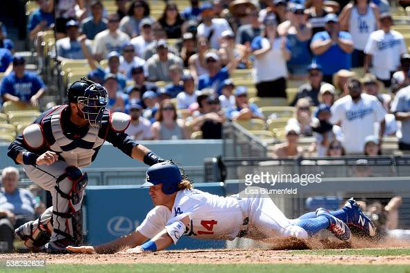 Enrique Hernandez of the Los Angeles Dodgers is out at home plate in the fifth inning against AJ Pierzynski of the Atlanta Braves at Dodger Stadium...