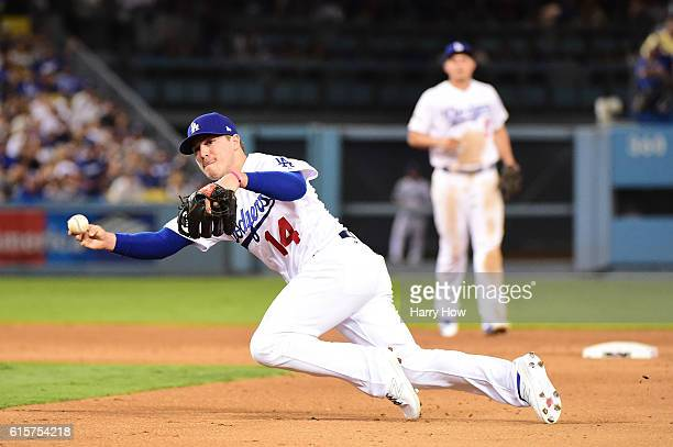 Enrique Hernandez of the Los Angeles Dodgers makes a bad throw and is unable to make a play in the sixth inning on a ball hit by cAddison Russell of...