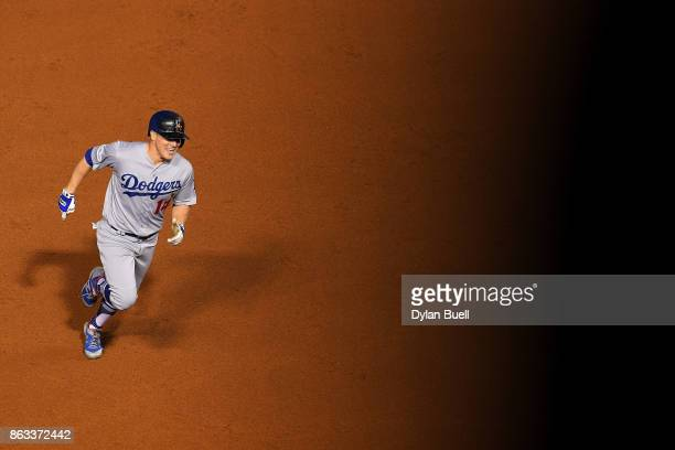 Enrique Hernandez of the Los Angeles Dodgers rounds the bases after hitting a home run in the ninth inning against the Chicago Cubs during game five...
