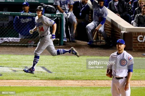 Enrique Hernandez of the Los Angeles Dodgers rounds the bases after hitting a home run in the ninth inning off Mike Montgomery of the Chicago Cubs...