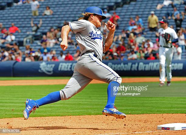 Enrique Hernandez of the Los Angeles Dodgers rounds third base to score the eventual gamewinning run in the 10th inning against the Atlanta Braves at...