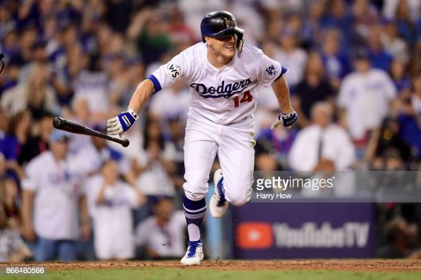 Enrique Hernandez of the Los Angeles Dodgers runs after hitting a RBI single to score Logan Forsythe in game two of the 2017 World Series against the...