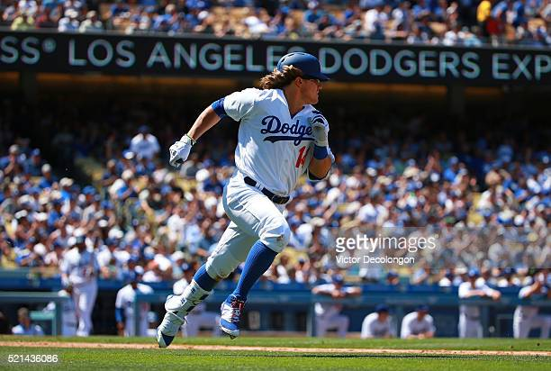 Enrique Hernandez of the Los Angeles Dodgers runs to first base after hitting a single to left field against pitcher Patrick Corbin of the Arizona...