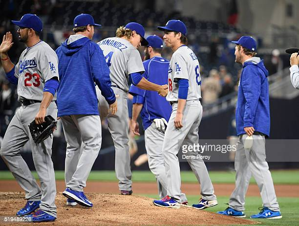 Enrique Hernandez of the Los Angeles Dodgers shakes hands with Kenta Maeda after the Dodgers beat the San Diego Padres 70 in a baseball game at PETCO...