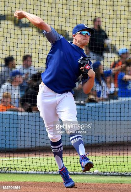 Enrique Hernandez of the Los Angeles Dodgers warms up before the game against the Chicago White Sox at Dodger Stadium on August 15 2017 in Los...