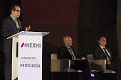 Enrique Hidalgo president of ExxonMobil Ventures Mexico left speaks as Jose Antonio Gonzalez Anaya chief executive officer of stateowned oil company...