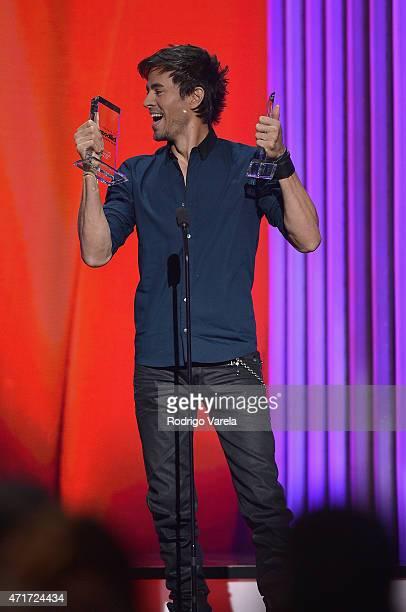 Enrique Iglesias accepts award at the 2015 Billboard Latin Music Awards presented bu State Farm on Telemundo at Bank United Center on April 30 2015...