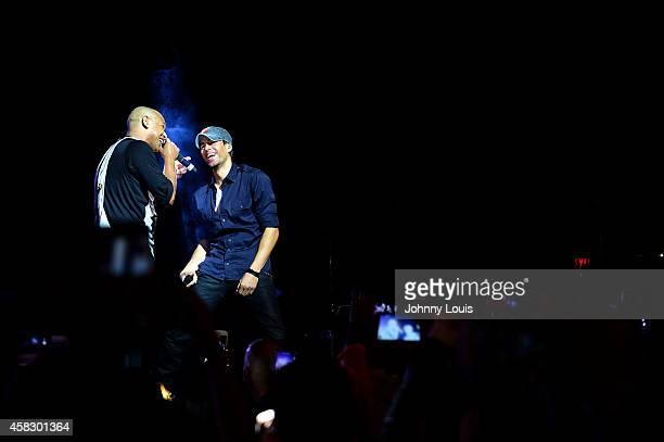 Enrique Iglesias and Alexander Delgado of Gente De Zona perform at James L Knight Center on November 1 2014 in Miami Florida