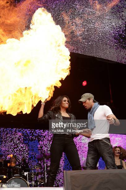Enrique Iglesias and Ciara performing on stage during Capital 958 Summertime Ball with Barclaycard at the Emirates Stadium