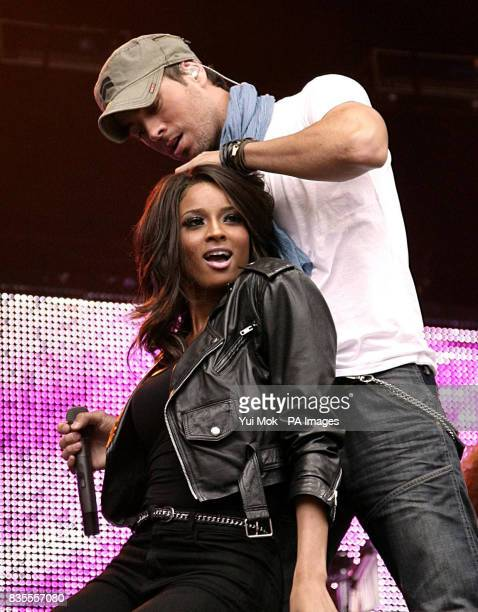 Enrique Iglesias and Ciara performing on stage during the Capital 958 Summertime Ball with Barclaycard at the Emirates Stadium in London