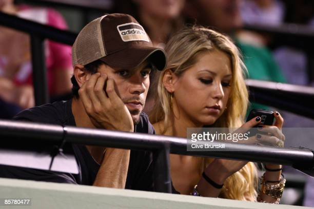 Enrique Iglesias and girlfriend Anna Kournikova watch as Venus Williams plays her semifinal match against Serena Williams at the Sony Ericsson Open...