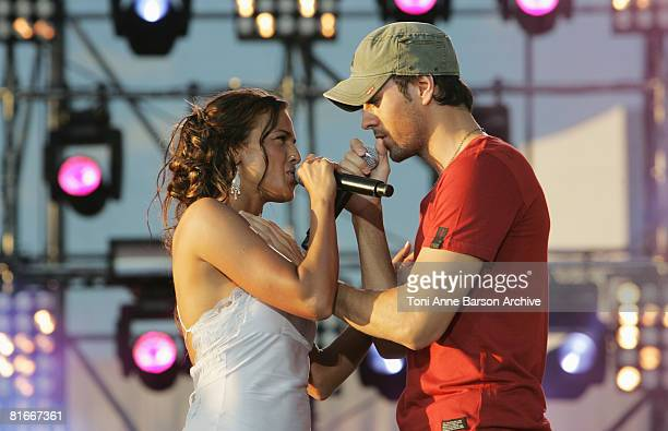 Enrique Iglesias and Nadiya perform at the France 2 Television's 'Fete de la Musique' at the Auteuil Horse track on June 21 2008 in Paris France