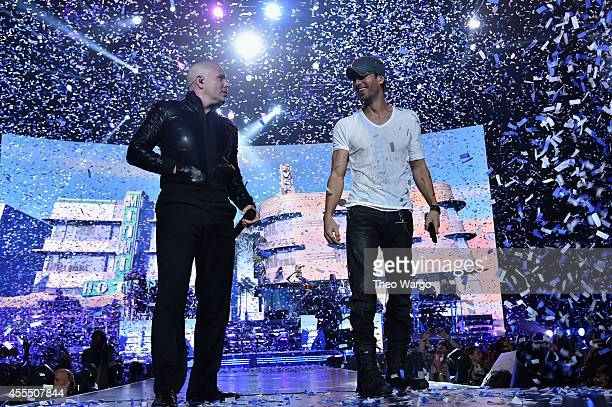 Enrique Iglesias and Pitbull with special guest J Balvin perform at opening night of US tour at Prudential Center on September 12 2014 in Newark New...