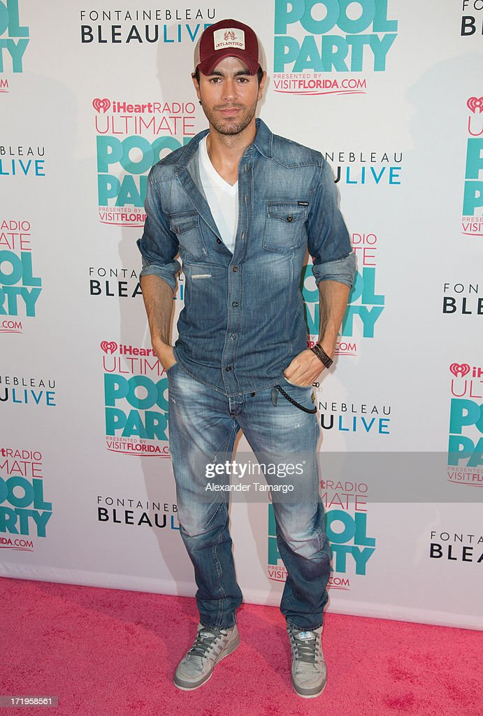 <a gi-track='captionPersonalityLinkClicked' href=/galleries/search?phrase=Enrique+Iglesias+-+Singer&family=editorial&specificpeople=202672 ng-click='$event.stopPropagation()'>Enrique Iglesias</a> attends iHeartRadio Ultimate Pool Party Presented By VISIT FLORIDA at Fontainebleau Miami Beach on June 29, 2013 in Miami Beach, Florida.