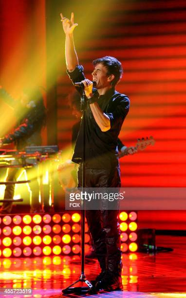 Enrique Iglesias performs on FOX's 'The X Factor' Season 3 Top 4 To 3 Live Elimination Show on December 12 2013 in Hollywood California