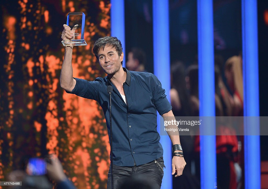 <a gi-track='captionPersonalityLinkClicked' href=/galleries/search?phrase=Enrique+Iglesias+-+Singer&family=editorial&specificpeople=202672 ng-click='$event.stopPropagation()'>Enrique Iglesias</a> performs onstage at the 2015 Billboard Latin Music Awards presented bu State Farm on Telemundo at Bank United Center on April 30, 2015 in Miami, Florida.