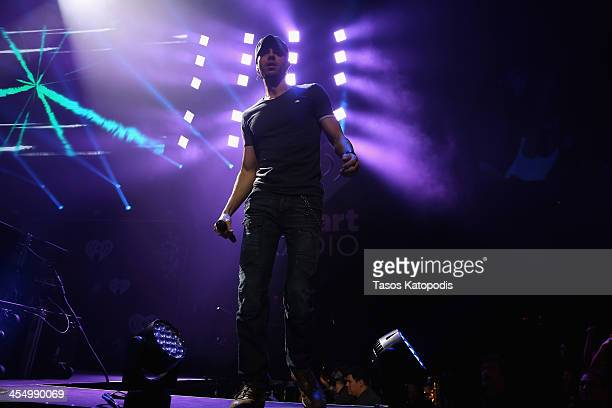Enrique Iglesias performs onstage during 1013 KDWB's Jingle Ball 2013 at Xcel Energy Center on December 10 2013 in St Paul Minnesota