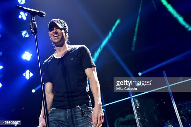 Enrique Iglesias performs onstage during KISS 108's Jingle Ball 2013 at TD Garden on December 14 2013 in Boston MA
