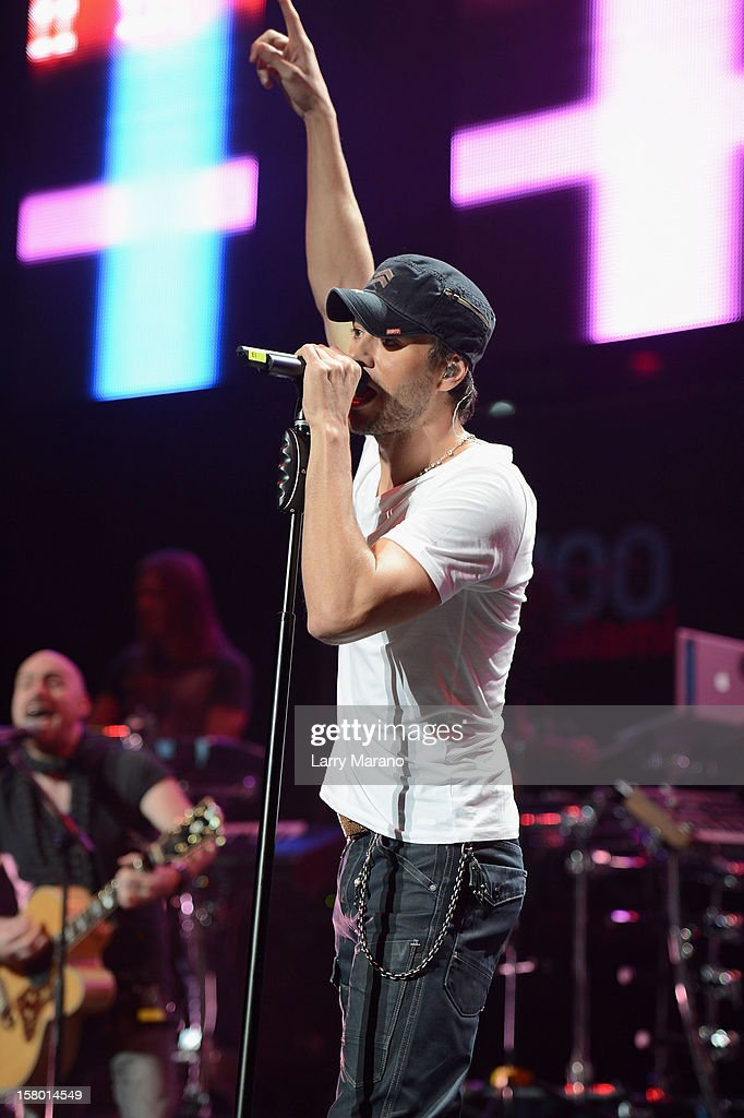 <a gi-track='captionPersonalityLinkClicked' href=/galleries/search?phrase=Enrique+Iglesias+-+Singer&family=editorial&specificpeople=202672 ng-click='$event.stopPropagation()'>Enrique Iglesias</a> performs onstage during the Y100's Jingle Ball 2012 at the BB&T Center on December 8, 2012 in Miami.