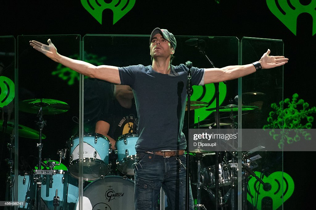 <a gi-track='captionPersonalityLinkClicked' href=/galleries/search?phrase=Enrique+Iglesias+-+Singer&family=editorial&specificpeople=202672 ng-click='$event.stopPropagation()'>Enrique Iglesias</a> performs onstage during Z100's Jingle Ball 2013 at Madison Square Garden on December 13, 2013 in New York City.