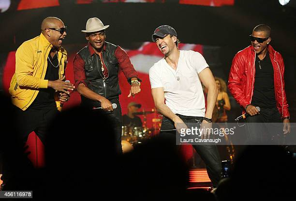 Enrique Iglesias performs with Randy Malcolm and Alexander Delgado of Gente Dezona and Sean Paul at Madison Square Garden on September 25 2014 in New...