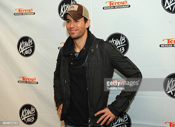 Enrique Iglesias poses backstage at 1013 KDWB's Jingle Ball 2013 at Xcel Energy Center on December 10 2013 in St Paul Minnesota