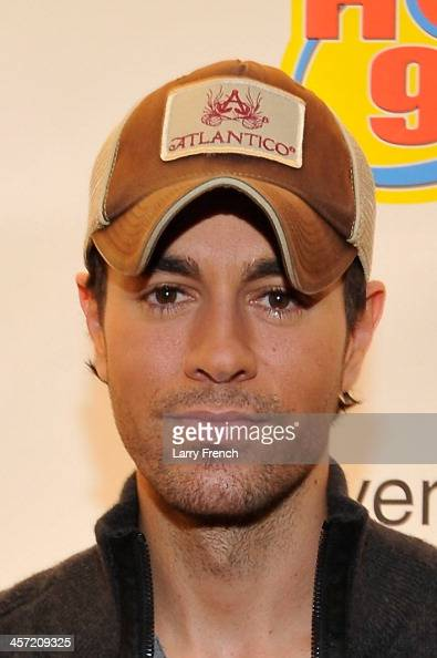 Enrique Iglesias poses backstage at Hot 995's Jingle Ball 2013 presented by Overstockcom at Verizon Center on December 16 2013 in Washington DC