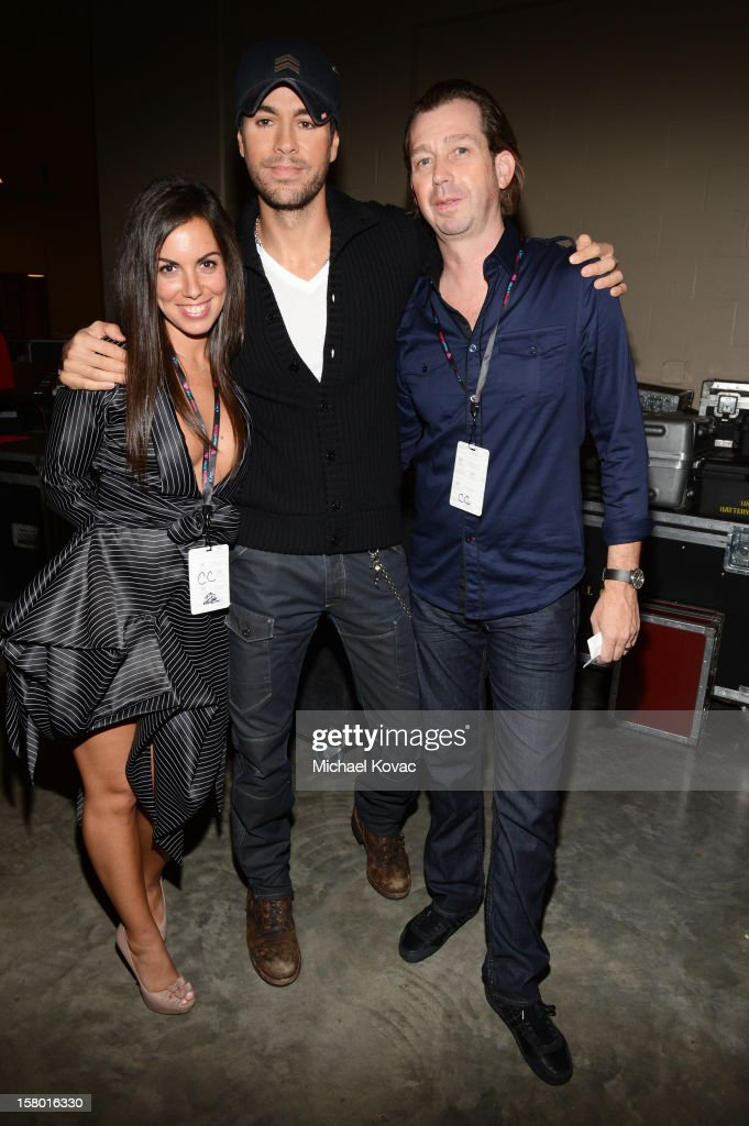 <a gi-track='captionPersonalityLinkClicked' href=/galleries/search?phrase=Enrique+Iglesias+-+Singer&family=editorial&specificpeople=202672 ng-click='$event.stopPropagation()'>Enrique Iglesias</a> (C) poses backstage at the Y100's Jingle Ball 2012 at the BB&T Center on December 8, 2012 in Miami.