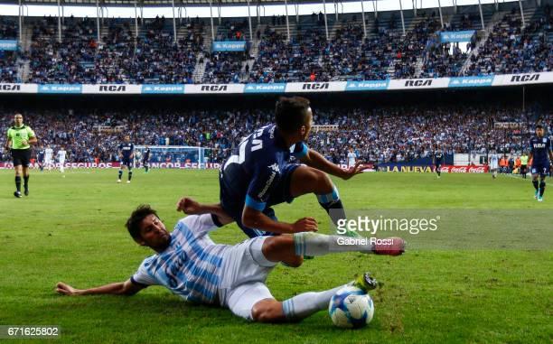 Enrique Meza of Atletico de Tucuman slides over Pablo Cuadra of Racing Club during a match between Racing and Atletico de Tucuman as part of Torneo...