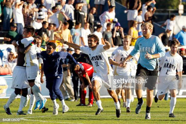 Enrique Paez of the University of Akron and the bench rush the field after their victory over the University of Louisville during the Division I...