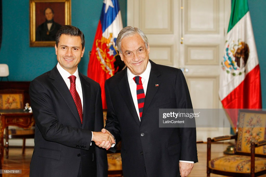 Enrique Peña Nieto, President-elect of Mexico, greets Chilean president Sebastian Piñera at Palacio de La Moneda during his visit to Chile on September 21, 2012 in Santiago, Chile.