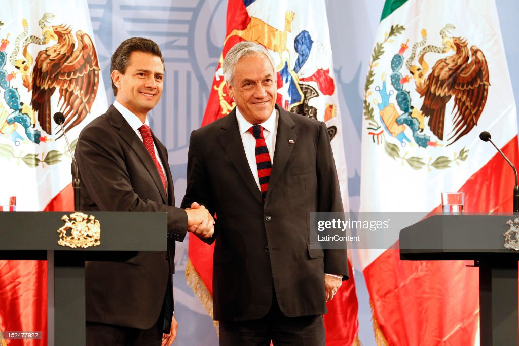 Enrique Peña Nieto, President-elect of Mexico greets Chilean president Sebastian Piñera at Palacio de La Moneda on September 21, 2012 in Santiago, Chile.