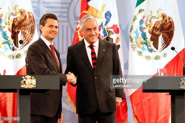 Enrique Peña Nieto Presidentelect of Mexico greets Chilean president Sebastian Piñera at Palacio de La Moneda on September 21 2012 in Santiago Chile
