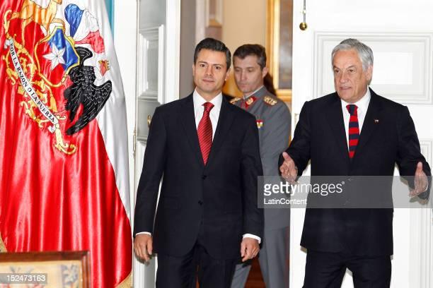 Enrique Peña Nieto Presidentelect of Mexico meets Chilean president Sebastian Piñera at Palacio de La Moneda during his visit to Chile on September...
