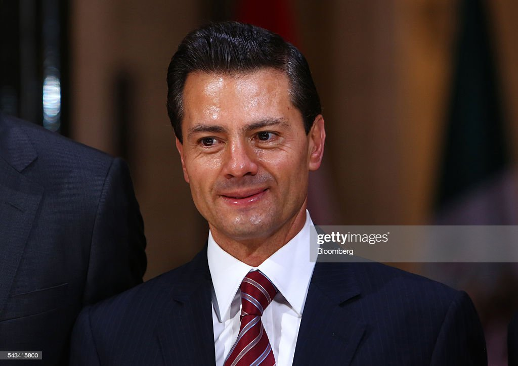 <a gi-track='captionPersonalityLinkClicked' href=/galleries/search?phrase=Enrique+Pena+Nieto&family=editorial&specificpeople=5957985 ng-click='$event.stopPropagation()'>Enrique Pena Nieto</a>, Mexico's president, arrives with Justin Trudeau, Canada's prime minister, not pictured, to Parliament Hill ahead of the North American Leaders Summit (NALS) in Ottawa, Ontario, Canada, on Tuesday, June 28, 2016. Trudeau. Nieto, and U.S. President Barack Obama hold the so-called Three Amigos summit Wednesday in Ottawa, with fallout from the U.K.'s vote last week to leave the European Union raising pressure to show confidence in their own alliance. The countries will vow to produce more clean power and cut methane emissions while strengthening economic ties. Photographer: Cole Burston/Bloomberg via Getty Images
