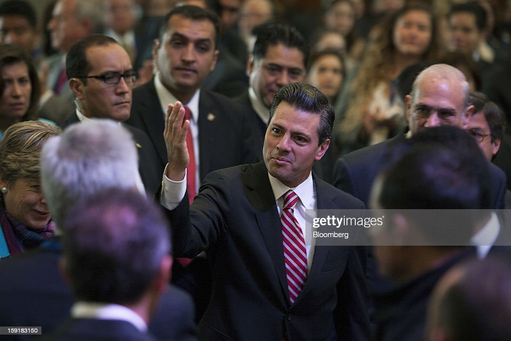 Enrique Pena Nieto, Mexico's president, center, arrives at the Mexico Forum 2013 in Mexico City, Mexico, on Wednesday, Jan. 9, 2013. Mexico's Congress today confirmed Eduardo Medina Mora, the former attorney general and envoy to the U.K., as the nation's next ambassador to the U.S. Photographer: Susana Gonzalez/Bloomberg via Getty Images