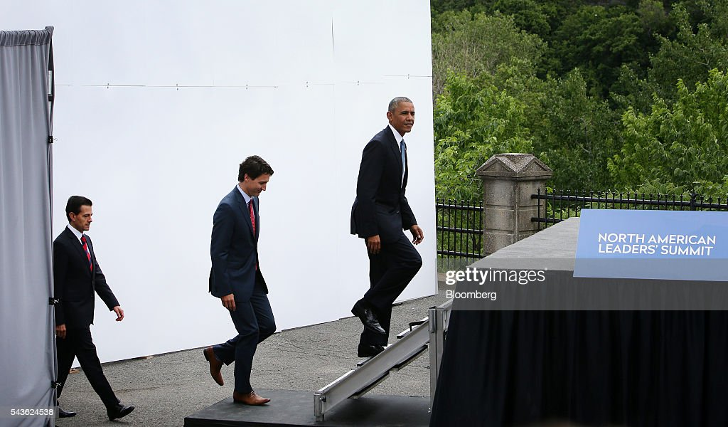 Enrique Pena Nieto, Mexico's president, from left, Justin Trudeau, Canada's prime minister, and U.S. President Barack Obama arrive for a photograph in front of Parliament Hill during the North American Leaders Summit (NALS) in Ottawa, Ontario, Canada, on Wednesday, June 29, 2016. Leaders from the three Nafta nations 'agree on the need for governments of all major steel-producing countries to make strong and immediate commitments to address the problem of global excess steelmaking capacity,' according to a statement from Trudeau. Photographer: Cole Burston/Bloomberg via Getty Images