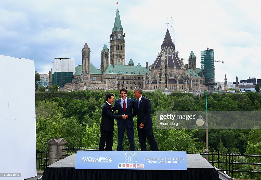 Enrique Pena Nieto, Mexico's president, from left, Justin Trudeau, Canada's prime minister, and U.S. President Barack Obama stand for a photograph in front of Parliament Hill during the North American Leaders Summit (NALS) in Ottawa, Ontario, Canada, on Wednesday, June 29, 2016. Leaders from the three Nafta nations 'agree on the need for governments of all major steel-producing countries to make strong and immediate commitments to address the problem of global excess steelmaking capacity,' according to a statement from Trudeau. Photographer: Cole Burston/Bloomberg via Getty Images