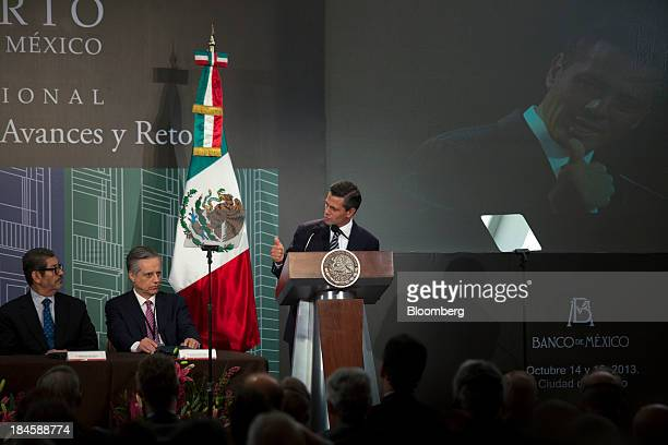 Enrique Pena Nieto Mexico's president right speaks during the Banco de Mexico 20th Anniversary Of Independence Conference in Mexico City Mexico on...