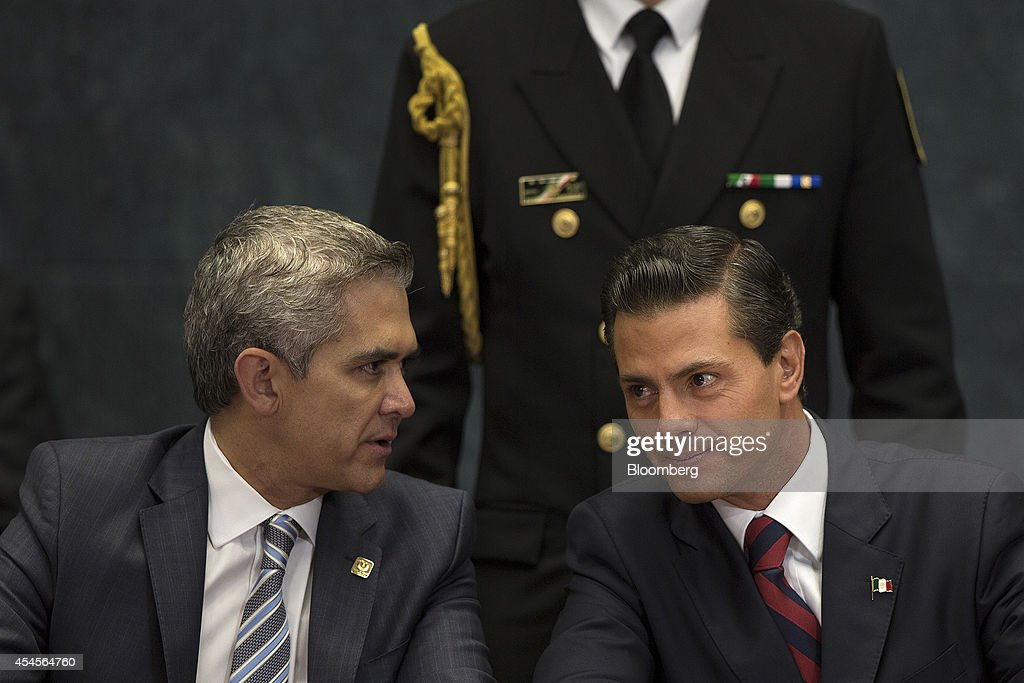 <a gi-track='captionPersonalityLinkClicked' href=/galleries/search?phrase=Enrique+Pena+Nieto&family=editorial&specificpeople=5957985 ng-click='$event.stopPropagation()'>Enrique Pena Nieto</a>, Mexico's president, right, speaks with Miguel Angel Mancera, mayor of Mexico City, during an announcement about plans for building a new airport in Mexico City, Mexico, on Wednesday, Sept. 3, 2014. Pena Nieto's plans to build a six-runway airport outside the capital sets the stage for competition from local builders and international groups to get a piece of the $9.2 billion project. Photographer: Susana Gonzalez/Bloomberg via Getty Images