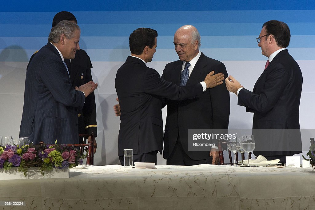 Enrique Pena Nieto Mexico's president second left greets Francisco Gonzalez chairman of Banco Bilbao Vizcaya Argentaria SA second right as Luis...